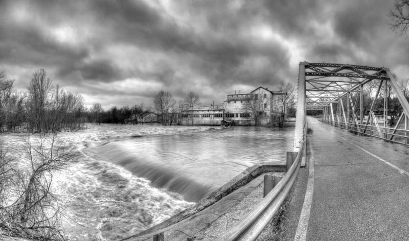 black and white;horizontal;bridge;building;water;street;mill;bridge;sky;clouds;ozark mill;ozark missouri;flood;dramatic